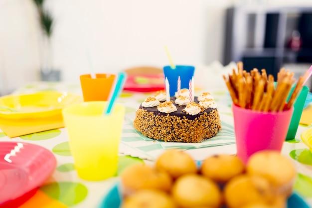 Still life birthday snacks on table