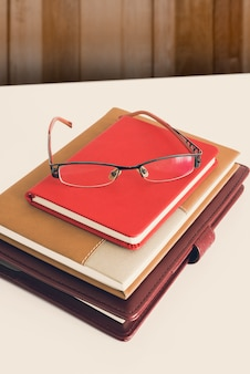 Still life, business, education concept. glasses with notebook on a table
