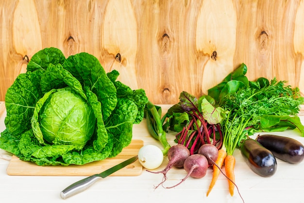 Still life, composition of fresh ripe organic natural vegetables on wooden table