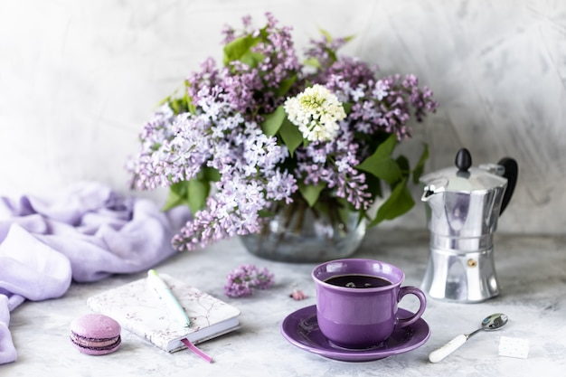 Still life cup of coffee, lilac flowers