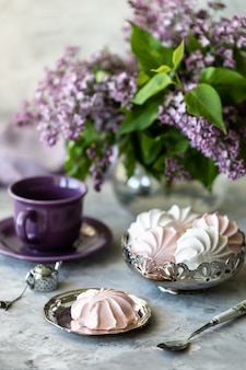 Still life cup of coffee, lilac, marshmallow