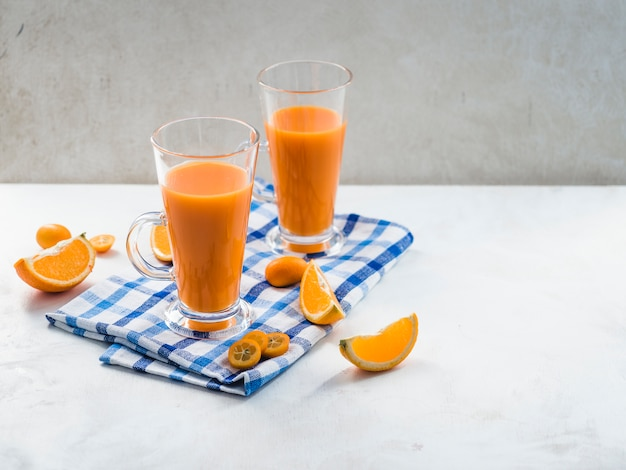 Still life of delicious orange smoothie