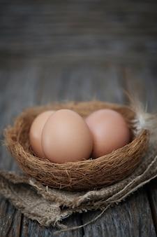 Still life-eggs on nest arranged in a rustick scene