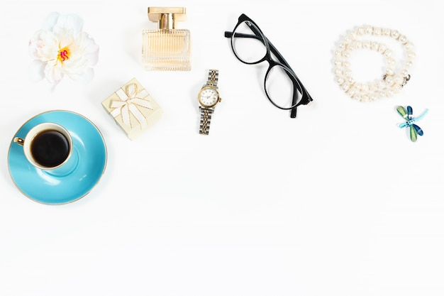 Still life of fashion woman objects on white background, top view