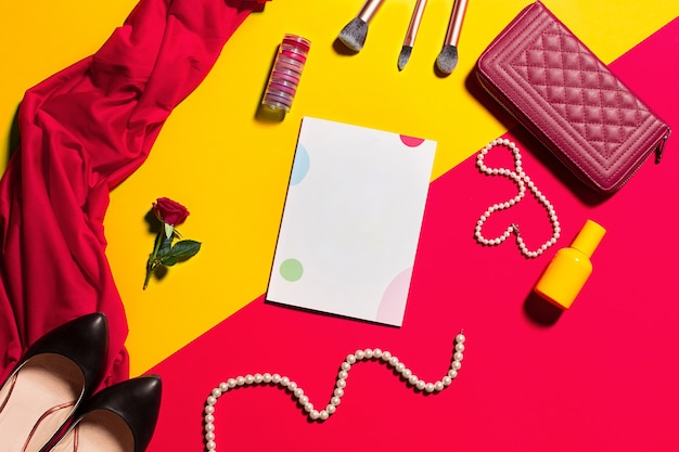 Still life of fashion woman, objects on yellow and red table