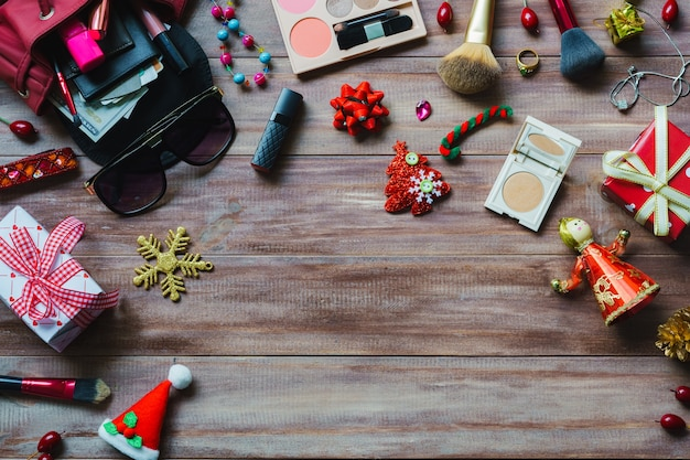 Still life flat lay of colorful makeup cosmetic with christmas decoration
