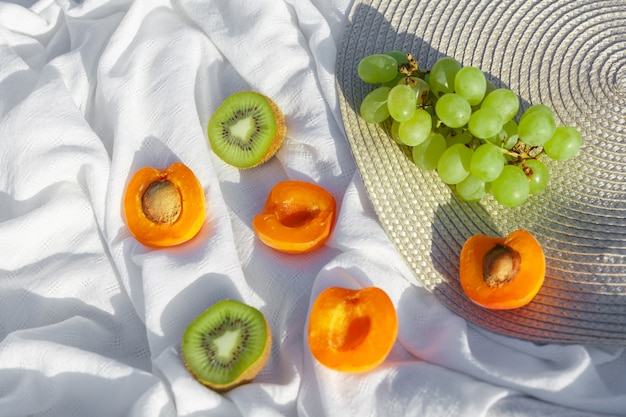 Still life and food photo fruits lie on crumpled fabric