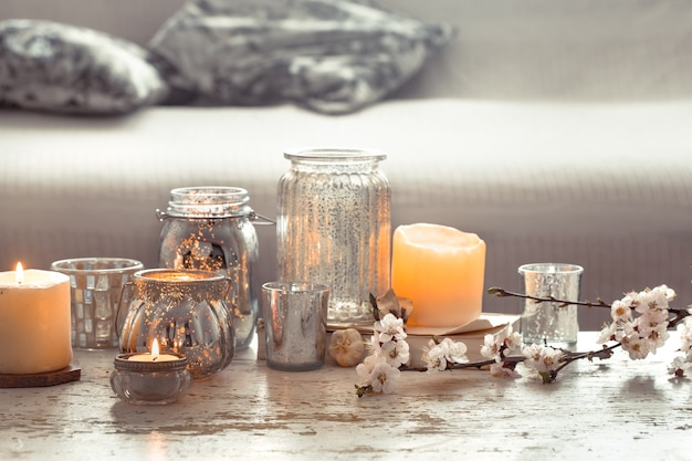Still-life. home cozy beautiful decor in the living room, vase and candles, on the background of a wooden table, interior details concept Premium Photo