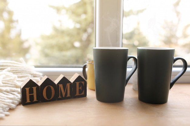 Still life home decor in a cozy house with wooden letters with the inscription home