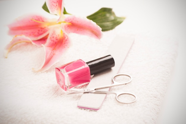 Still life of manicure equipment on white table