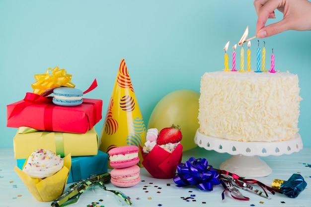 Still life of tasty birthday cake with presents