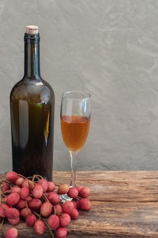 Still life of wine with lychee
