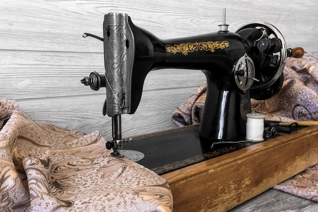 Still life with antique sewing machine and fabrics