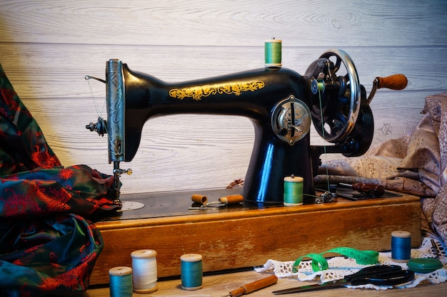 Still life with antique sewing machine and a variety of sewing accessories