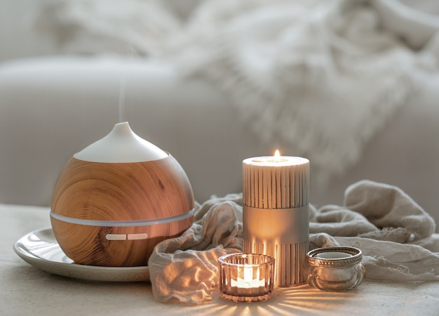 Still life with an aroma diffuser for moisturizing the air and burning candles.