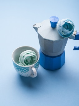 Still life with blue coffee maker and flower