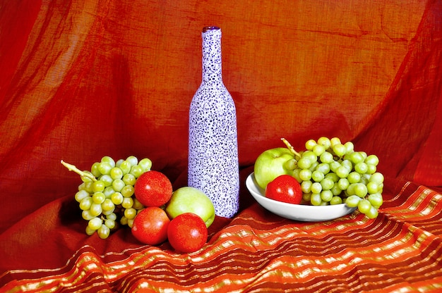Still life with bottle and fruit