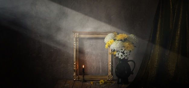 Still life with chrysanthemums and golden wooden frame