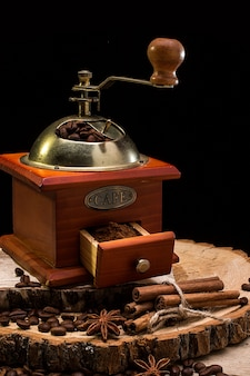 Still life with coffee beans and old coffee mill