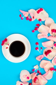 Still life with cup of coffee and flowers. beautiful morning concept