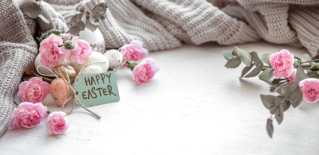 Still life with details of the festive easter decor and the inscription happy easter on the postcard