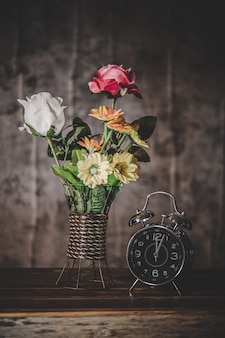 Still life with flower vases and clocks