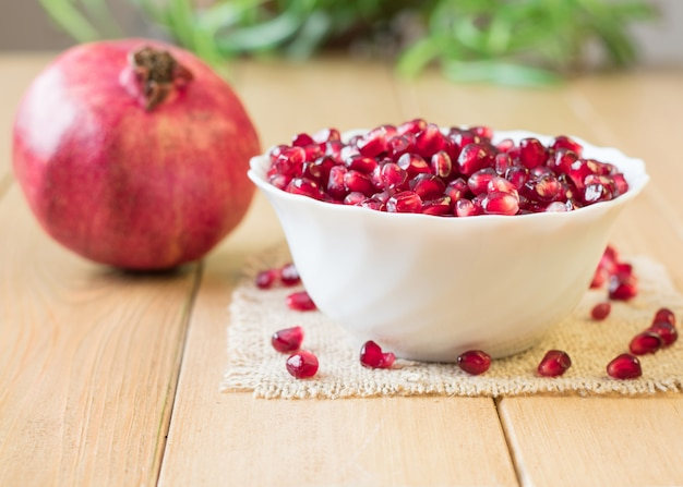 Still life with fresh pomegranate on a wooden table.