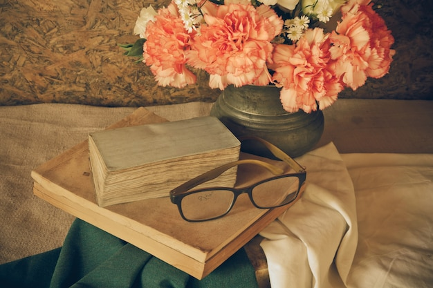 Still life with glasses resting on a book