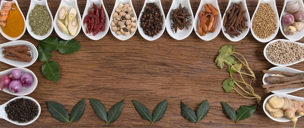 Still life with herbs and spices places on a old wooden background.top view