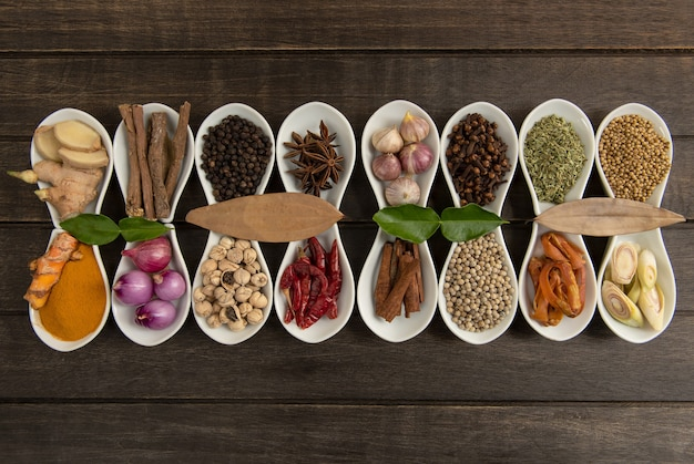 Still life with herbs and spices places on a old wooden table.top view