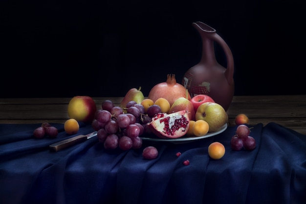 Still life with a jug of wine and fruit on a plate (pomegranate, red grapes, apples and pears, apricots) on a dark blue linen tablecloth. horizontal orientation.