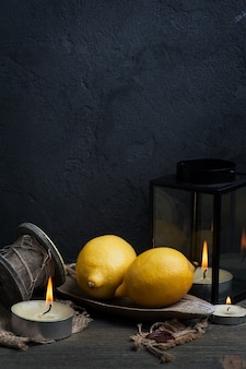 Still life with lemons and candles background