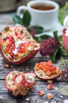 Still life with open pomegranate on wood