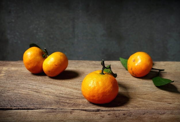 Still life with orange fruites on wooden table with grunge space