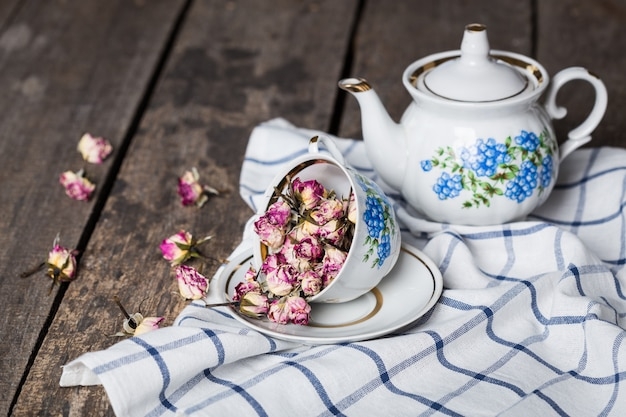 Still life with tea cup and tablecloth on wooden table