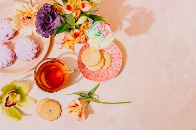Still life with tea and flowers. postcard for women's day