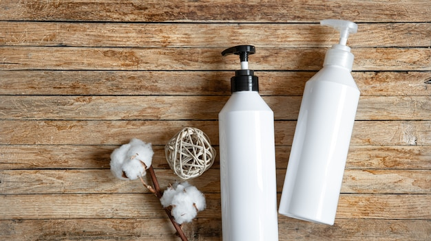 Still life with white mock-up bottles with dispenser top view. hygiene, health and beauty concept.