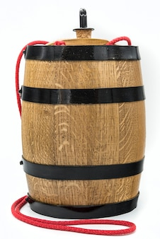 Still life with white wine, bottle and barrel