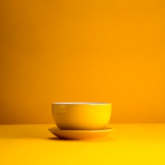 Still life of yellow cup