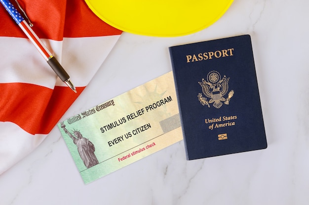 Stimulus relief check on passport of usa on american flag about form 7200, advance payment of employer credits due to covid-19
