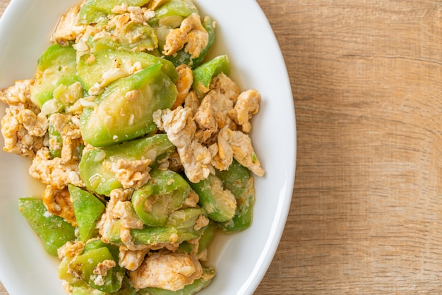 Stir fried angled gourd with egg, healthy food style