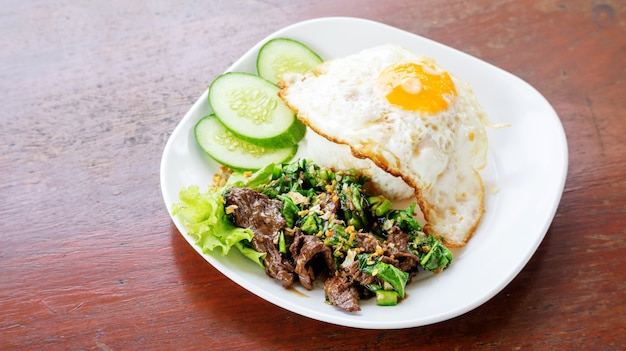 Stir fried beef and kale with jasmine rice and fried egg, thai food.