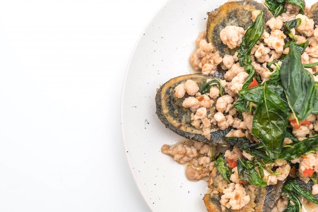 Stir-fried century egg and minced pork with holy basil leaves