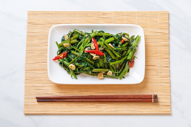 Stir-fried chinese morning glory or water spinach, asian food style