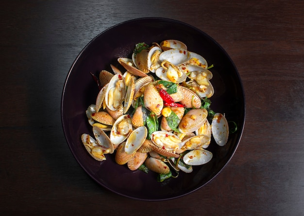 Stir fried clams with roasted chilli paste in a plate