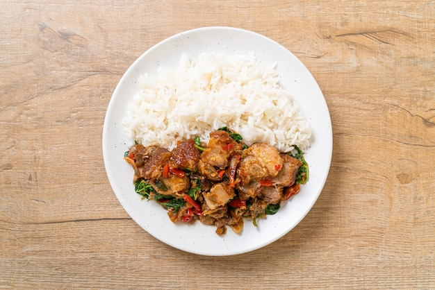 Stir-fried crispy pork belly and basil with rice - asian local street food style