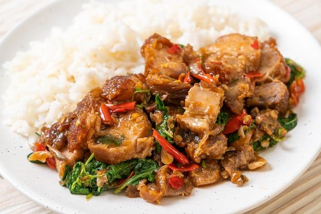Stir-fried crispy pork belly and basil with rice
