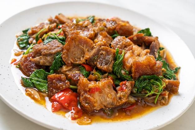 Stir-fried crispy pork belly and basil
