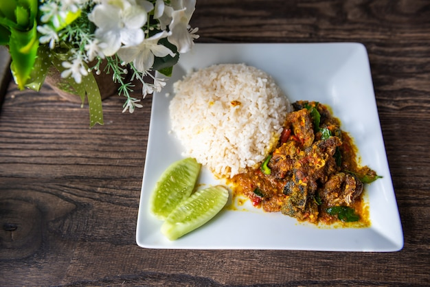 Stir fried deep fried catfish with curry paste and rice