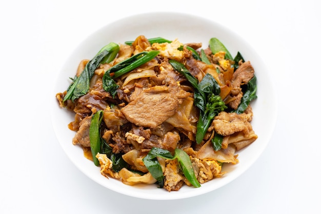 Stir fried flat noodle and pork with soy sauce.
